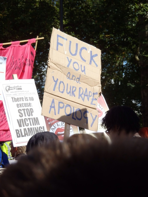 """Slutwalk sign """"Fuck you and your rape apology"""" , """"There is no excuse: stop victim blaming!"""""""
