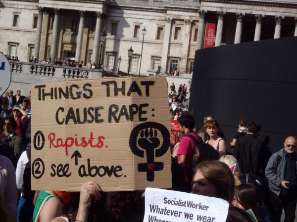 "Slutwalk sign ""Things that cause rape: (1) Rapists (2) See above"""